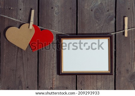 Two Paper Hearts And Frame On String