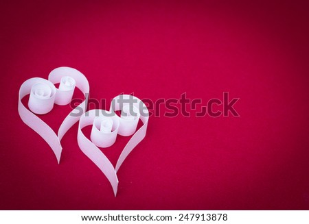 two Paper hearts for Valentines day on red background - stock photo