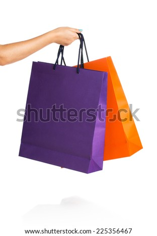 Two paper Shopping bags in woman hand