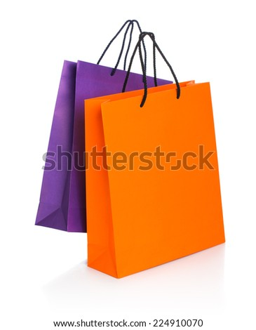 Two paper Shopping bags with reflection on white background - stock photo
