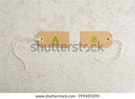 Two paper tags with letters A and B. Concept of options, choices and alternative strategy.