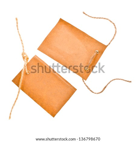 two paper tags with metal grommet and the rope  isolated on white background - stock photo