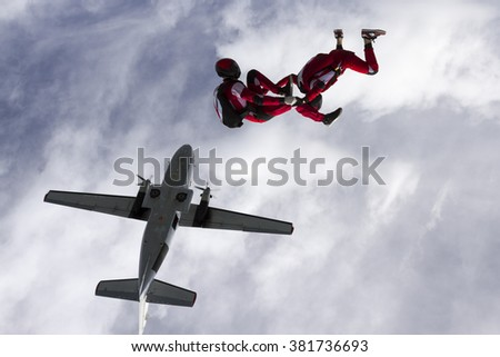Two parachutists jumped from a plane.