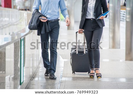 Two Passenger  walking in passenger terminal at the airport.business trip concept