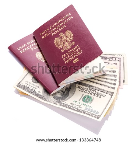 Two passports with American dollars money - stock photo