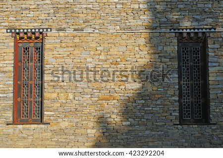 Two pattern on rock wall (sunlight & shade)