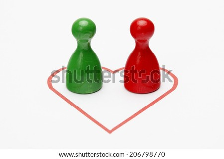 Two pawns in a Heart - stock photo