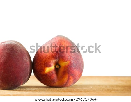 Two peaches on the wooden background, selective focus, isolated on white - stock photo