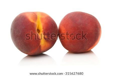 Two peachs on white background  - stock photo