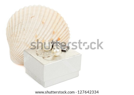 two pearl earrings, shells and gift box isolated on white background - stock photo