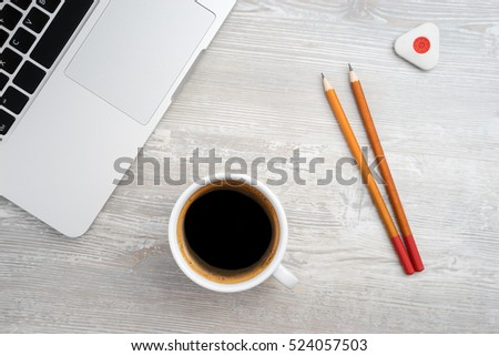 Two pencil, eraser and coffee on the table