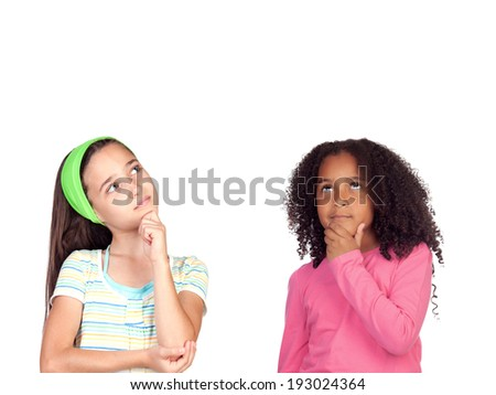 Two pensive little girl isolated on a white background - stock photo