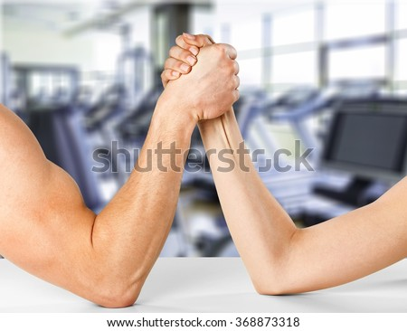 Two People arm wrestling. - stock photo