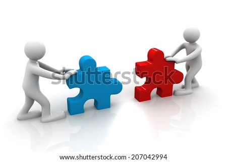 Two people assemble tow piece of a puzzle - stock photo