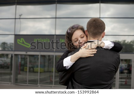 Two people at the airport  - stock photo