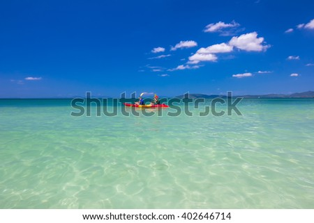 Two people canoeing in the andaman sea ,Krabi, Thailand - stock photo
