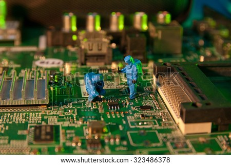 Two people checking integrated circuits. The concept technology. - stock photo