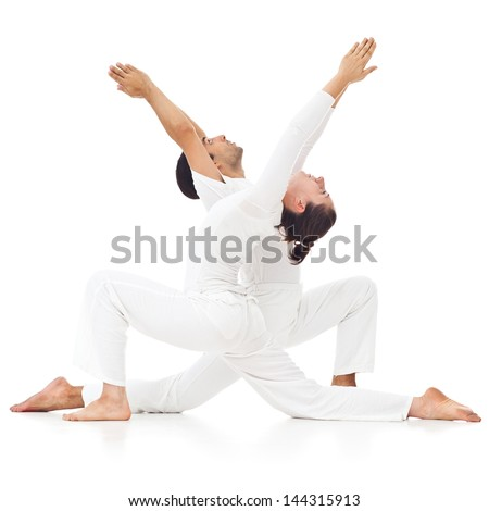 Two people doing yoga together.