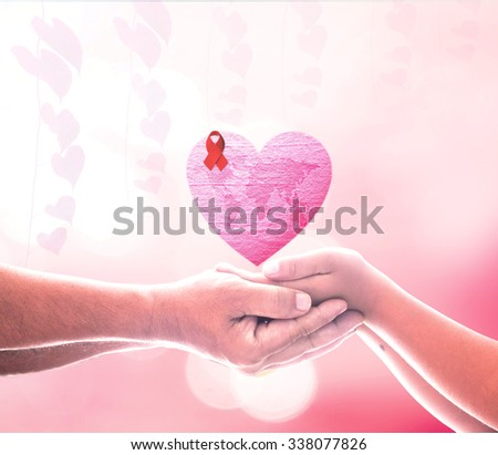 Two people hands holding world map stock photo royalty free two people hands holding world map on pink heart made of fabric texture and red ribbon gumiabroncs Gallery