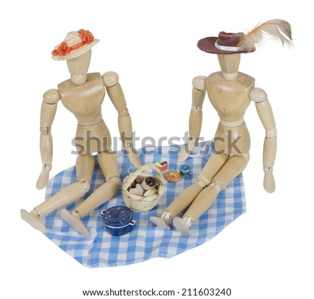 Two people having a Picnic with a basket and food on a blue gingham blanket  - path included - stock photo