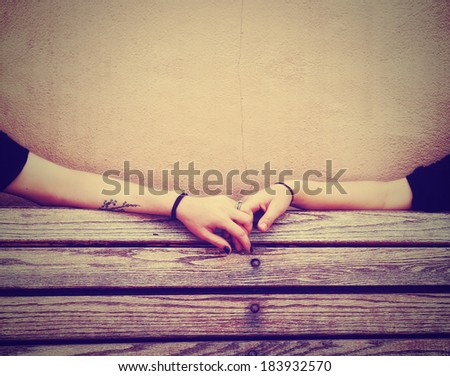 two people holding hands on a bench done with a retro vintage instagram filter - stock photo