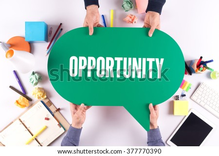 Two people holding speech bubble with OPPORTUNITY concept - stock photo