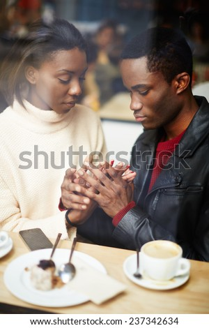 Two people in cafe enjoying the time spending with each other, portrait of young couple in love at coffee shop, young couple at san valentines day, handsome man declaration of love for his girlfriend - stock photo