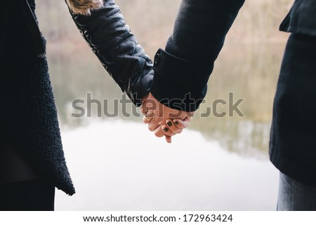 two people in love holding hands - stock photo