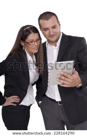 two people looking at the digital tablet