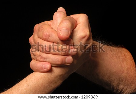Two people meet and shake hands