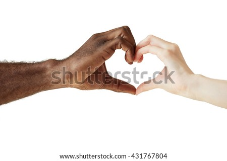 Two people of different races and ethnicities holding hands in the shape of a heart, symbolizing love, peace and unity. African man and Caucasian woman holding hands together. Interracial love concept - stock photo