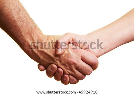 Two people shaking their hands - stock photo