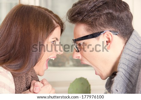 two people shouting and screaming at each other - stock photo