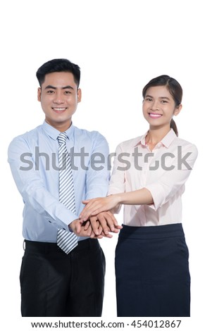 Two people standing with their hands on top each other and smiling isolated
