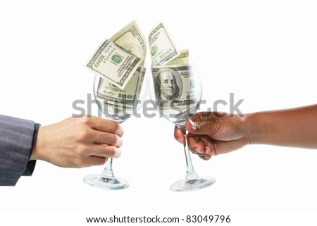Two people toast using glass filled with dollar bills, isolated on white - stock photo