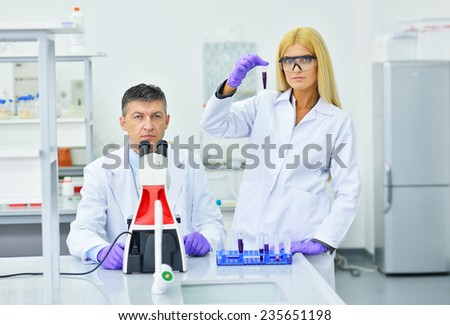two people working in the laboratory - stock photo