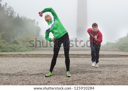 two people workout in the morning - stock photo