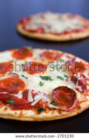 Two Pepperoni Pizzas on a Table