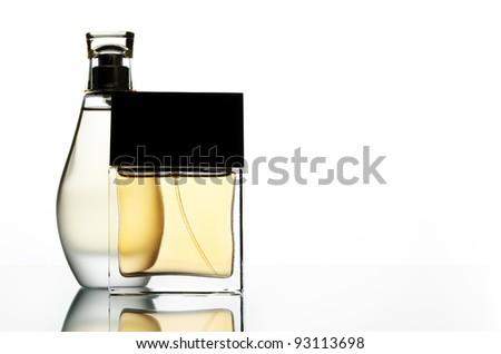 Two perfume bottles on a whute backdrop - stock photo