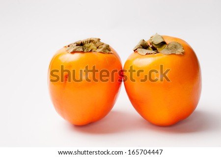 Two Persimmon on a White Background