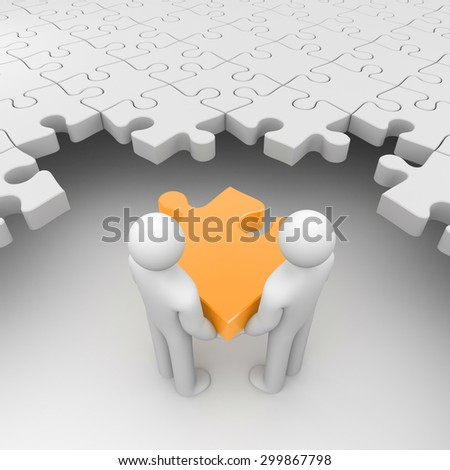 Two persons holding orange puzzle surrounded by white puzzles - stock photo