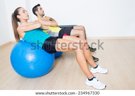 Two persons making functional training  - stock photo