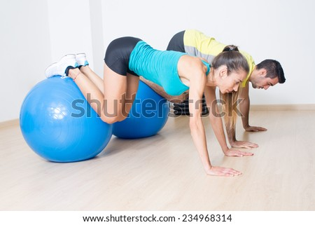 Two persons making functional training with med ball  - stock photo