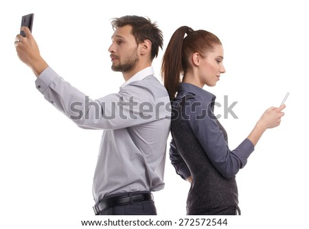 Two persons too busy with their mobile phones - stock photo