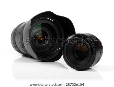 two photo camera lenses isolated on white - stock photo