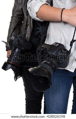 Two photographers holding camera isolated on white