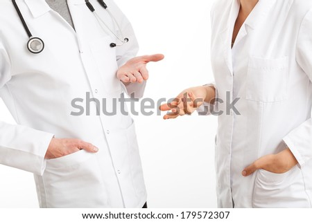 Two physicians gesticulating during a medical council