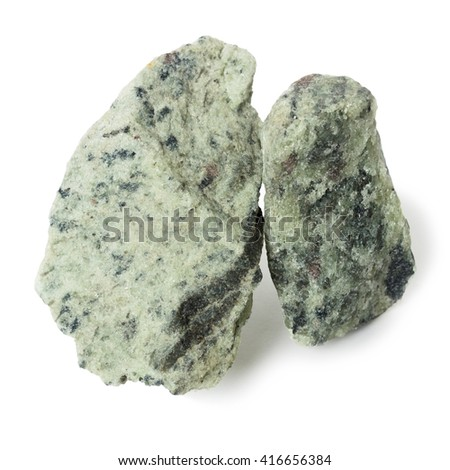 Two piece apatite nepheline ore, raw material for production of fertilizers - stock photo