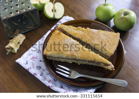 Two pieces of apple pie on the table