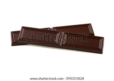 Two pieces of black chocolate on white background